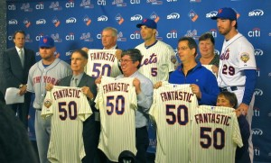 Mets players pose with 50-year season ticket holders with their new jerseys.
