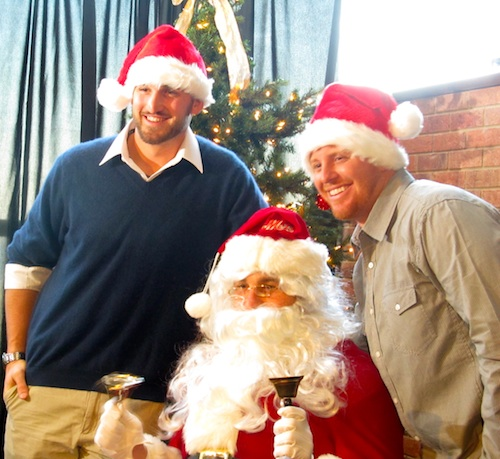 Daniel Murphy as Santa flanked by his elves Jonathon Niese and Justin Turner (Photo by Jim Mancari)