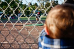 boy fence baseball