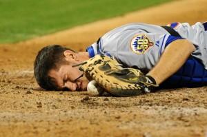 Jose Bautista slugs baseballs.  Ty Wigginton slugs catchers.  Just ask Josh Thole, assuming he can remember.