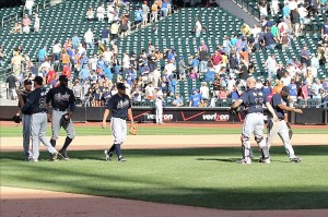 Braves celebrate after Bobby Parnell allows the winning run to score.