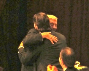 Phil Niekro and R.A. Dickey embrace.