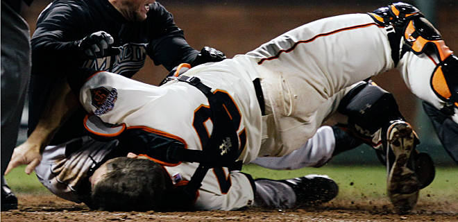 San Francisco Giants catcher Buster Posey suffers a broken left ankle and torn knee following a devastating collision at home plate.