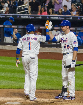 An enthusiastic high-five and an ecstatic dugout after the Valdespin homers. (Gordon Donovan)