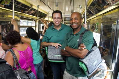 """Baseball all-star Willie Randolph, right, and Jared """"The SUBWAY Guy""""  ride the 7 train while giving out the new limited edition SUBWAY bag that encourages healthier lifestyles on Tuesday, July 16, 2013 in New York. (Photo by Charles Sykes/Invision for SUBWAY/AP Images)"""