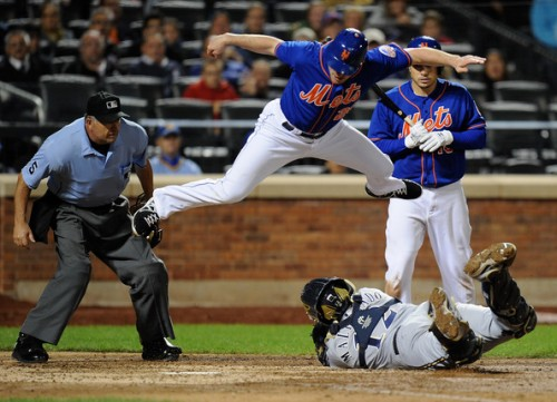 Doubles, stolen bases, death-defying leaps over catchers.  Is there anything Daniel  Murphy can't do?