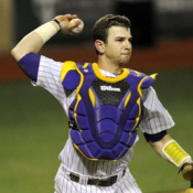 select LSU catcher Tyler - Moore in sixth round.