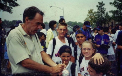 Young Trevor learns the finer points of baseball signing from Grandpa Teddy