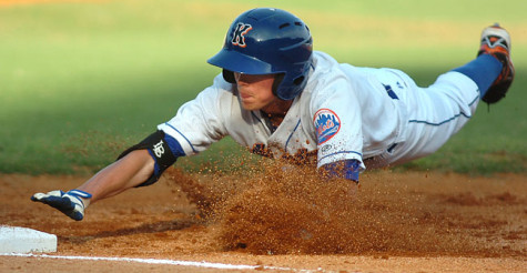#11 for the K-Mets dives safely back into first. Photo by ned Jilton II